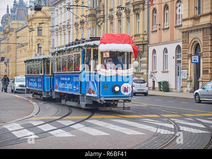 Santa Claus tram, as part of the Advent Market celebration in Zagreb, going through the streets of the capital - Stock Image