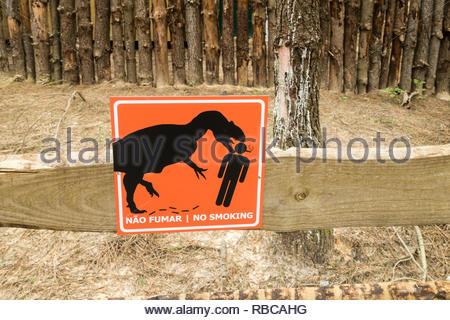 humorous no smoking sign in Dino Parque, Lourinha, Portugal - Stock Image