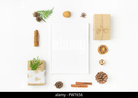 White Christmas frame mockup. Gift boxes in craft paper tied with twine fabric ribbon pine cones juniper nuts cinnamon. New Year presents holiday prep - Stock Image