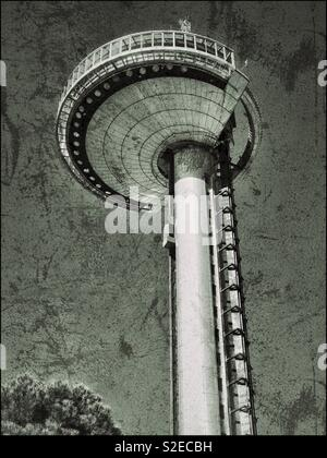 A grunge effect picture of the famous Faro de Moncloa - a 92metre high observation tower that provides panoramic views over Madrid, Spain. Observation Tower or Space Ship?! Photo © COLIN HOSKINS. - Stock Image
