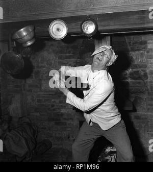 Comedian Richard Heane tossing a pancake on Shrove Tuesday 1951. February 1951 B608 - Stock Image