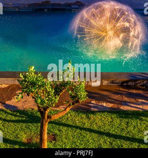 spherical fountain on blue sky,round fountain on the water, beautiful fountain in the Park,refreshing fountain - Stock Image