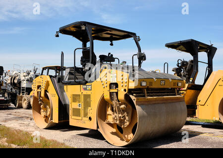 CAT CB64B tandem roller or compactor used for asphalt road construction and asphalt paving in Montgomery Alabama, USA. - Stock Image