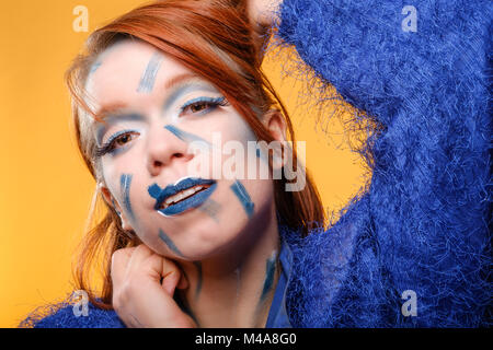 Pretty, redheaded / ginger, young woman with crazy make-up © Jeremy Graham-Cumming - Stock Image