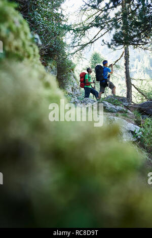 Hikers stopping for break, Mont Cervin, Matterhorn, Valais, Switzerland - Stock Image