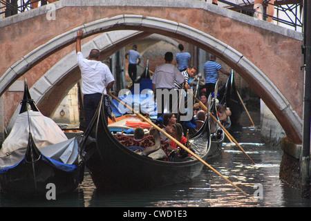 Gondola traffic jam in Venice, Italy - Stock Image