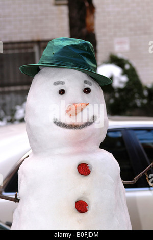 Snowman with a hat in New York City, upper east side - Stock Image