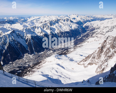 View from Aiguille du Midi above valley with snow on the French Alps. Chamonix-Mont-Blanc, Haute Savoie, Rhone-Alpes, France - Stock Image