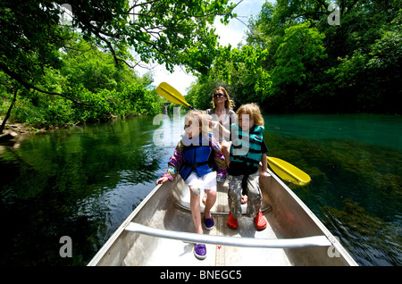 Family has rented canoe on the Colorado River in Austin, Zilkar Park Texas, USA - Stock Image