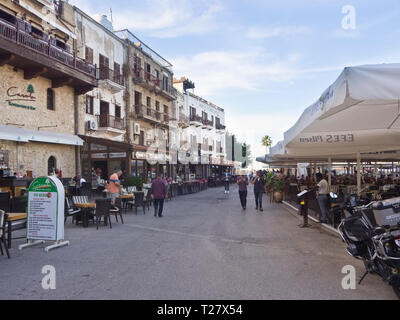 The harbour area in the old town of Kyrenia ( Girne ) Cyprus has a well sheltered marina, countless restaurants and a popular promenade - Stock Image