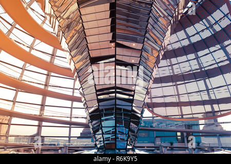 Glass dome on the roof of the Reichstag in Berlin. The mirrors reflect the daylight to inside the building. Popular travel destination - Stock Image