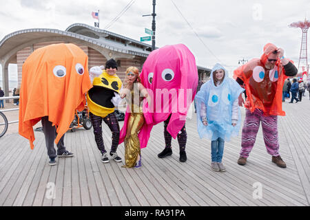 A mermaid and 4 people dressed as Pacman characters pose prior to  the annual Polar Bear Club New Year's day swim in Coney Island, Brooklyn, NYC. - Stock Image