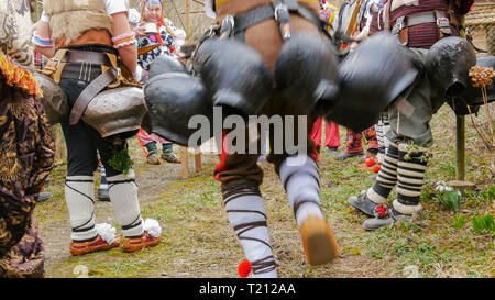 Turia, Bulgaria, 9 March 2019. Masquerade ritual Kukeri  to expel evil.  People from the village wear big bells and terrible costumes. They're called  - Stock Image