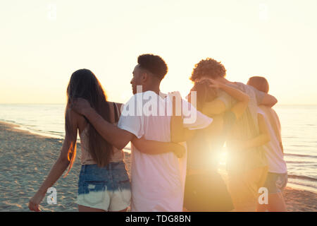 Group of friends having fun on the beach. Concept of summertime - Stock Image