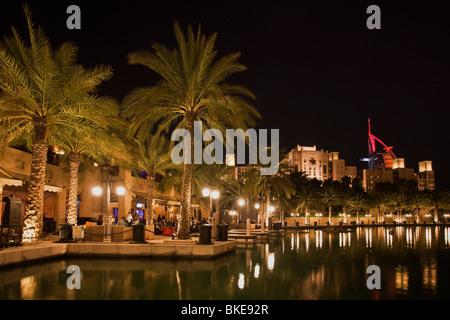 Medinat Jumeirah in the evening, canal, illumination, bars, restaurants, Dubai, United Arab Emirates - Stock Image