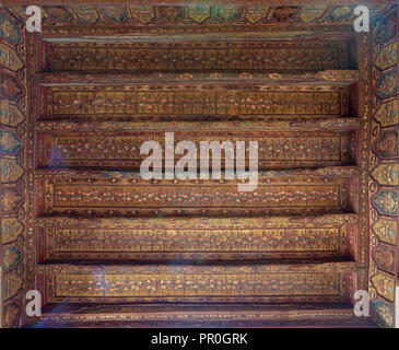 Ottoman era decorated wooden ceiling with golden floral pattern decorations at historic House of Egyptian Architecture, located in Darb El Labbana - Stock Image