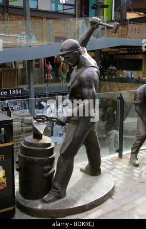 Statue of a Blacksmith in the New Camden Market Development, London, UK - Stock Image