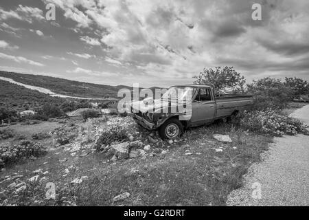 Rusty abandoned truck in a rural landscape. abandoned truck in a rural landscape. - Stock Image
