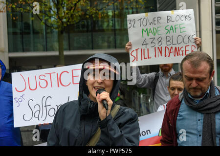 London, UK. 17th October 2018. A woman speaks at the protest outside the Ministry of Housing, Communities and Local Government by residents living in tower blocks covered in Grenfell-style cladding, Fuel Poverty Action, and Grenfell campaigners demanding that the government make all tower-block homes safe and warm. Credit: Peter Marshall/Alamy Live News - Stock Image