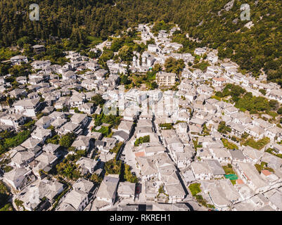 Greek traditional white houses with stone roofs in Panagia town, central Thasos Island, Greece - Stock Image