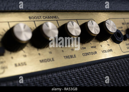 vintage amplifier five knobs diagonal close up - Stock Image