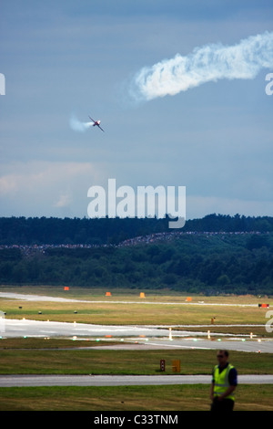 UK Air Force Red Arrows display team British Aerospace Hawk T1 thrills crowds at Farnborough International Airshow - Stock Image