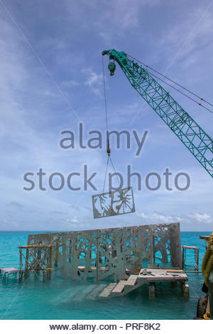 Construction of the Coralarium sculpture installation in Maldives - Stock Image