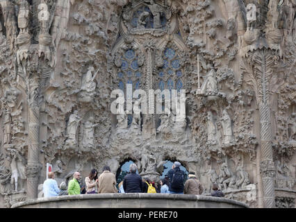 Tourists And Visitors Wait For Entry To The Sagrada Familia Cathedral Designed By Antoni Gaudí In Barcelona Spain - Stock Image