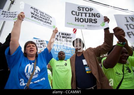 Walmart employees demonstrate in front of the Walmart Home Office in Bentonville, Ark. - Stock Image