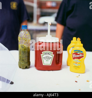 Heinz tomato ketchup bottle, relish and French's mustard on a hamburger and hotdog stand Fort Erie Ontario Canada KATHY DEWIT - Stock Image