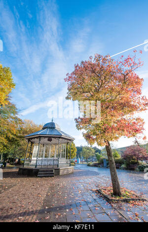 Beautiful Victorian bandstand in historic Dartmouth, Devon in a public park with trees in stunning autumn colours - Stock Image
