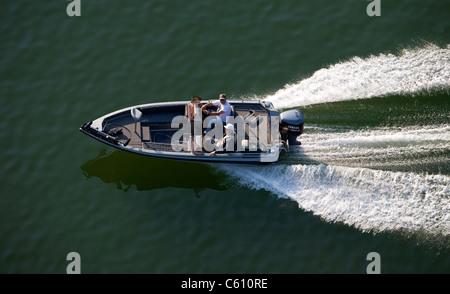 Aerial photo of two elderly men underway in a small bass fishing boat on Lock Lomond in Bella Vista, Ark. - Stock Image
