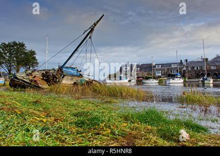 Sinking boat in harbour at Abersoch, Gwynedd, Wales - Stock Image