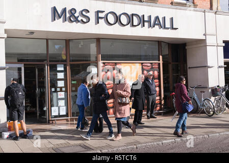 Cambridge, England - October 2018: People walking in front of M&S Mark and Spencer Foodhall entrance in Market square, Cambridge, UK - Stock Image