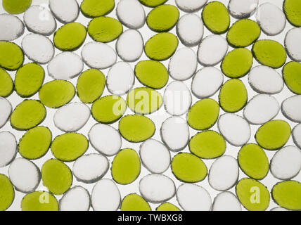 artificial round stones with water drop of green and white color, top view. imitation pebbles - Stock Image