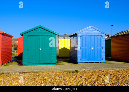 Colourful beach huts on Bulverhythe beach, St Leonards on Sea, East Sussex, UK - Stock Image