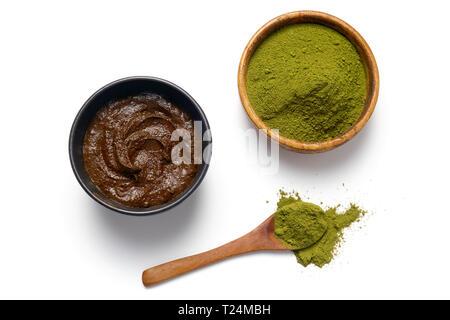 Herbal Henna powder and henna paste on white background. - Stock Image