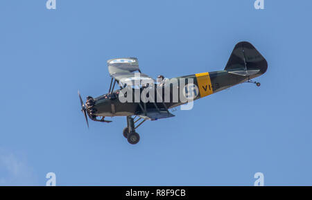 VL Viima vintage 1939 biplane two-seat trainer of the Finnish Air Force performing aerobatics at the FAF 100 Years Anniversary Air Show. - Stock Image