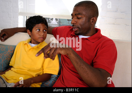 African American father and son having a heart to heart conversation - Stock Image