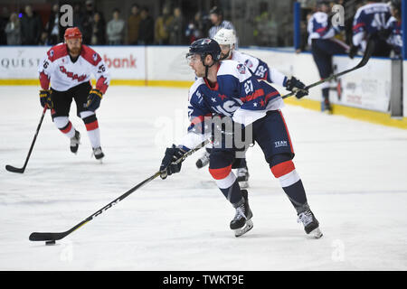 Melbourne, Australia. 21st June 2019, O'Brien Group Arena, Melbourne, Victoria, Australia; 2019 Ice Hockey Classic, Canada versus USA; Tim Harrison of USA moves the puck forward Credit: Action Plus Sports Images/Alamy Live News - Stock Image