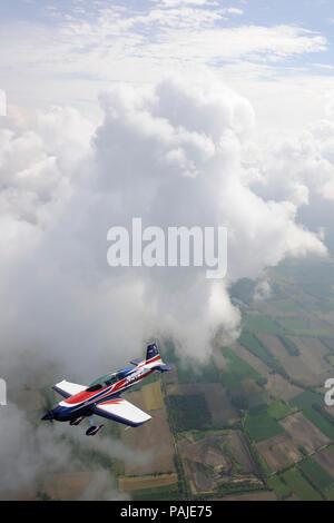 Doug Vayda flying the prototype Extra EA-330LT over the North Rhine-Westphalia area of Germany - Stock Image