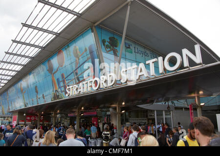 People leaving Olympic Park at Stratford Railway Station London E20 UK, - Stock Image