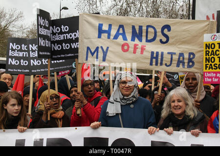 London, UK - 16 March 2019: Thousands of people  London, UK - 16 March 2019: A group of women adorning humans under a banner with the words 'Hands off my hijabs' joined thousands of people took part in the UN Anti-Racism Day demonstration that took place in central London on 16 March. The demonstration which began in Park Lank and ended outside Downing Street was organised by Stand Up to Racism and Love Music Hate Racism and supported by the TUC and UNISON. Photo: David Mbiyutook part in the UN Anti-Racism Day demonstration that took place in central London on 16 March. The demonstration w - Stock Image