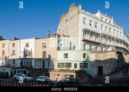 Georgian terraces of juxtaposed scales and levels at the corner of Royal York Crescent and Wellington Terrace in - Stock Image