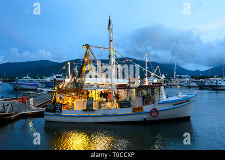People eating seafood in the evening on board the Prawn Star, a popular seafood restaurant fishing boat, Cairns, Far North Queensland, FNQ, QLD, Austr - Stock Image