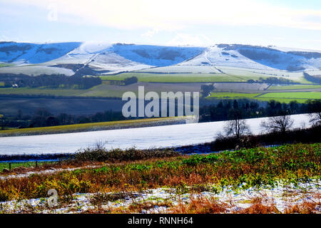 A patchwork of snow covered fields and rolling hills of the South Downs National Park, Lewes, East Sussex, UK on a sunny winters day. - Stock Image