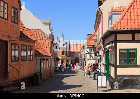 Old medieval Danish town cobbled street scene on Adelgade in Ebeltoft, Jutland, Denmark, Scandinavia - Stock Image