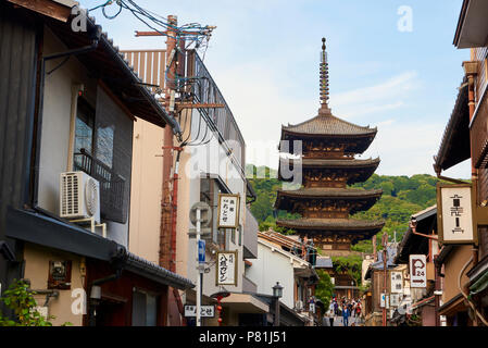 Hokanji Temple Pagoda in Kyoto, Japan, framed by residential buildings in the foreground. - Stock Image