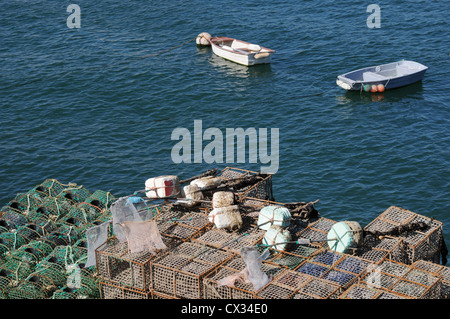 Lobster pots on the harbour wall in the Portugese resort town of Cascais - Stock Image