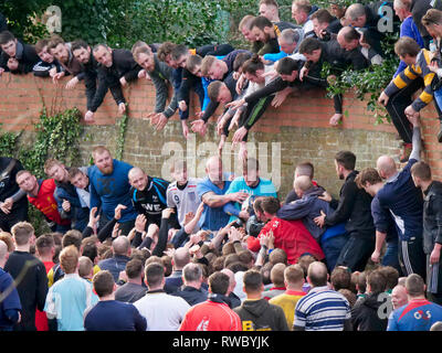 Ashbourne Derbyshire, UK. 5th Mar, 2019. Ashbourne Royal Shrovetide Football match on Shrove Tuesday. Ye Olde & Ancient Medieval hugball game is the forerunner to football. It's played between two teams, the Up'Ards & Down'Ards separated by the Henmore Brook river. The goals are 3 miles apart at Sturston Mill & Clifton Mill. Charles Cotton's poem Burlesque upon the Great Frost, dating from 1683, mentions this game at Ashbourne. He was the cousin of Aston Cockayne Baronet of Ashbourne, Derbyshire. Credit: Doug Blane/Alamy Live News - Stock Image